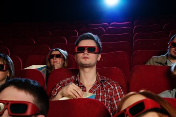 People in 3D glasses watching movie in cinema