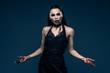 Beautiful vampire style woman in black dress