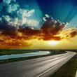 fantastic dramatic sunset over asphalt road