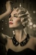 Elegant blond retro woman with beautiful hairdo and red lipstick