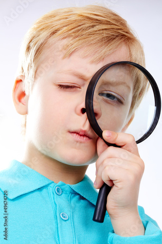 Looking through magnifying glass