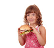 hungry little girl with big sandwich on white