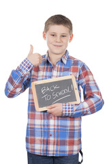 young boy holding slate