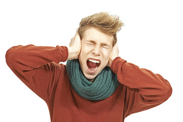 Young man covering his ears and scream