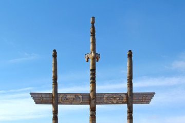 A wooden sculpture of the blue sky