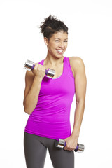 Young woman exercising holding dumbbells