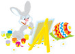 Easter Bunny drawing a colorful Easter egg