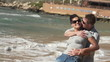 Couple in love on the beach, super slow motion