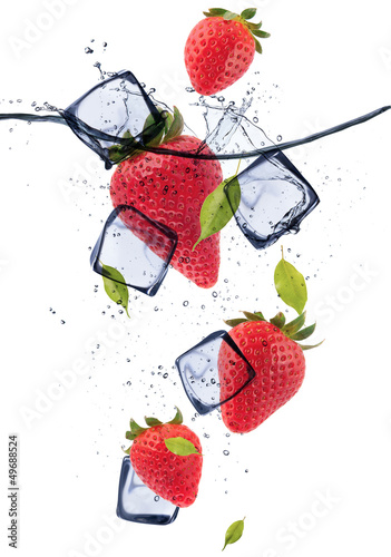 Strawberries with ice cubes, isolated on white background