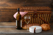 vintage picnic basket with wine - 49688781