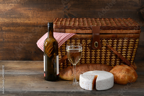 vintage picnic basket with wine