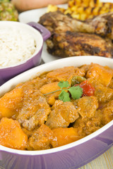 Lamb & sweet potato peanut stew, rice, jerk chicken & pineapple