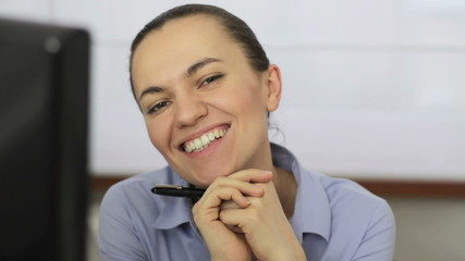 Happy business woman smiling to camera, close up