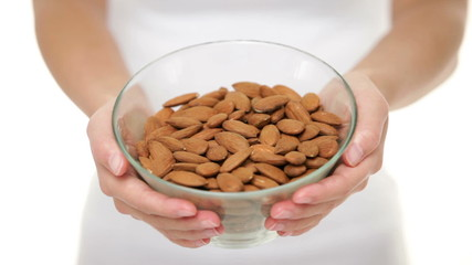 Almonds - woman showing almond bowl closeup