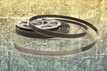 Still life of 8mm cine film reels over a grunge background