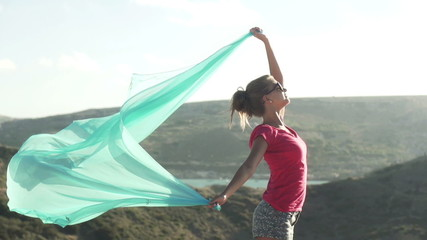 Woman with pareo outdoors, super slow motion, shot at 240fps