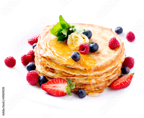 Pancake. Crepes With Berries. Pancakes stack isolated on White