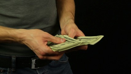 Man's hand counts the money