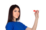 Attractive girl smiling throwing a dart