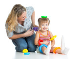 kid girl and mother playing together with toys