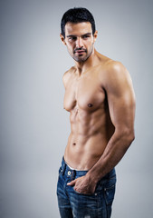 A handsome male model posing at a studio.
