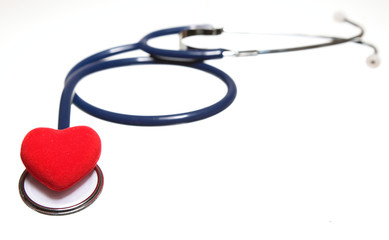 Red heart and a blue stethoscope isolated. Healthcare concept