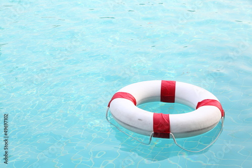red and white rescue wheel on swimming pool
