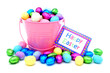 Happy Easter card with pink pail overflowing with candy