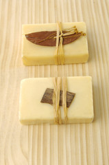 handmade soaps on wooden board