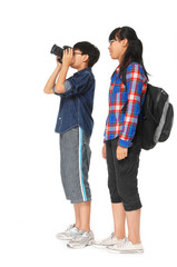 Couple children with a camera with laptop