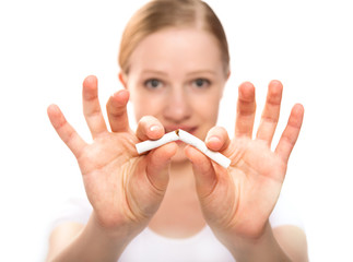 woman breaking cigarette. concept stop smoking