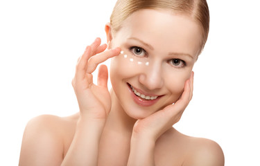 skin care. face of beautiful healthy woman with cream isolated