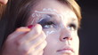 close up view of applying make up
