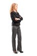 Full length portrait of a businesswoman standing with folded arm