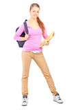 Full length portrait of a female student  holding backpac
