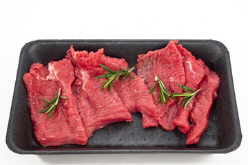 Supermarket packaged porterhouse steaks in white background