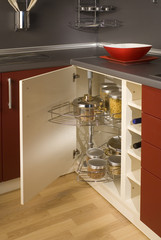 detail of a circular open kitchen cabinet with cans of beans