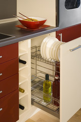 detail of a kitchen with an open drawer