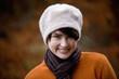 A portrait of a woman wearing a woollen hat in autumn time