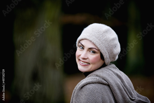 A portrait of a woman wearing a woollen hat in autumn time