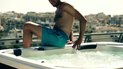 Man relaxing in jacuzzi on the terrace, slow motion shot at 120f