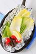 Fresh vegetables on tinfoil in skillet