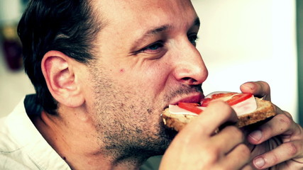 Man eating sandwich - close up, slow motion shot at 240fps