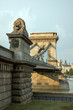 Guardian lion statue on famous Chain Bridge in  Budapest