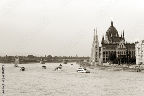 Boats cruising by Parliament building in Budapest