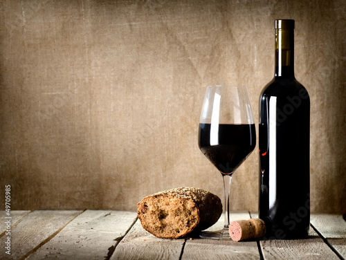 Wine and  bread on the table