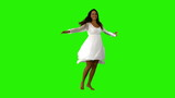 Girl in white dress twirling on green screen