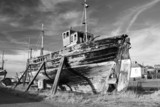 Old, ruined boat at Burghead harbour, Scotland