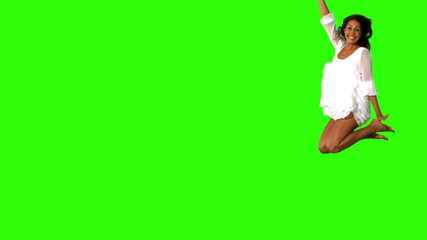 Girl in white dress jumping on green screen