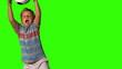 Little boy catching football on green screen